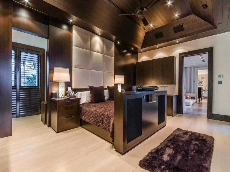 Dark master bedroom in Custom built celebrity home for Celine Dion