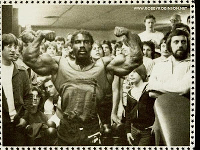 "ROBBY ROBINSON ON TOUR - FRONT DOUBLE BICEPS - NEW YORK CITY 70'S Read about RR's training and life experience, about other legends of Golden Era  of bodybuilding and what really happened behind the scenes of Weider's empire  in RR's BOOK ""The BLACK PRINCE; My Life in Bodybuilding: Muscle vs. Hustle""   ● www.robbyrobinson.net/books.php ●"