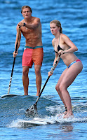 Ireland Baldwin paddleboarding on vacation with her boyfriend