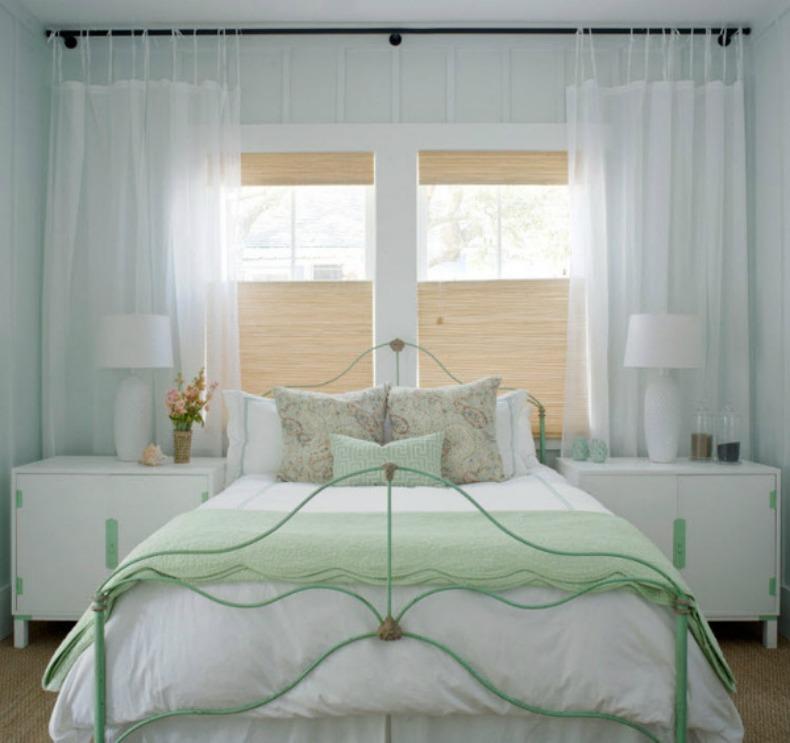 Coastal seafoam green and bright white guest room