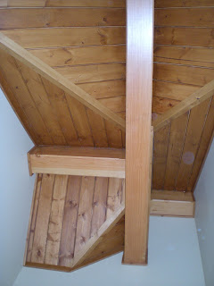 Douglas fir ceiling beams intersecting in ceiling