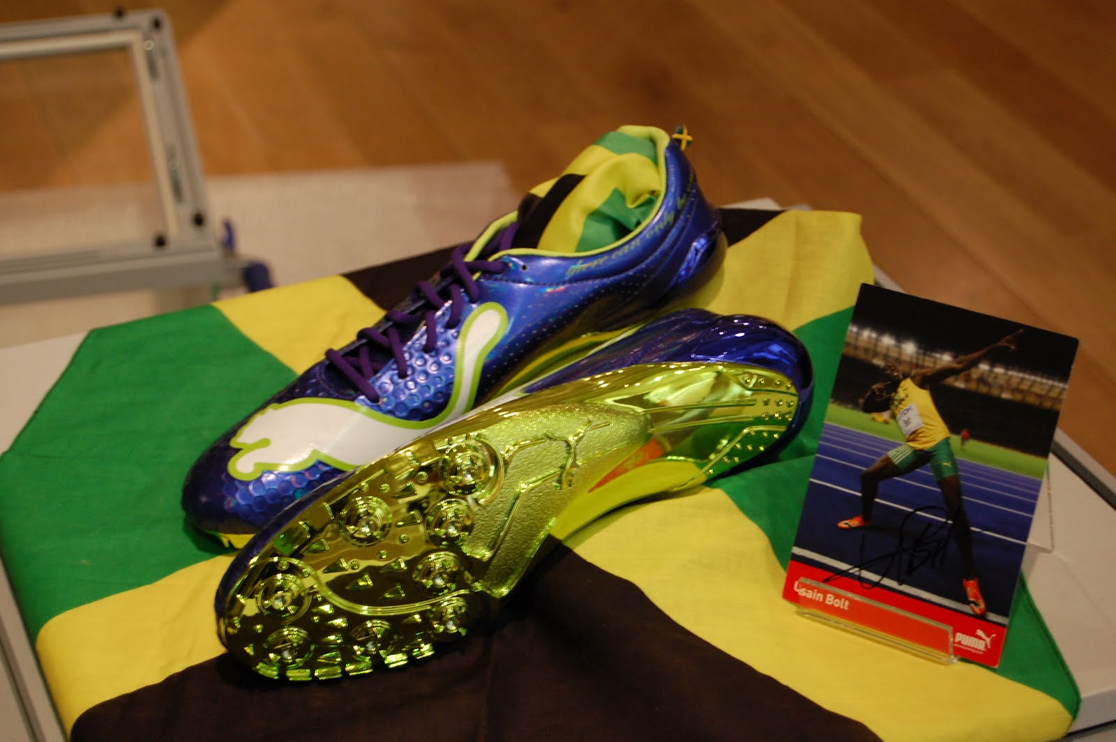 running spikes signed by superstar usain bolt sprint into
