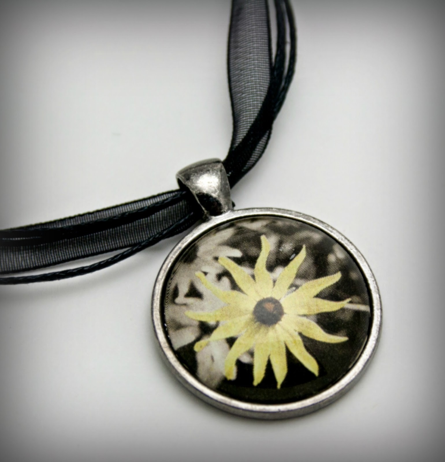 https://www.etsy.com/listing/188432237/black-eyed-susan-necklace-glass-pendant?ref=shop_home_active_13