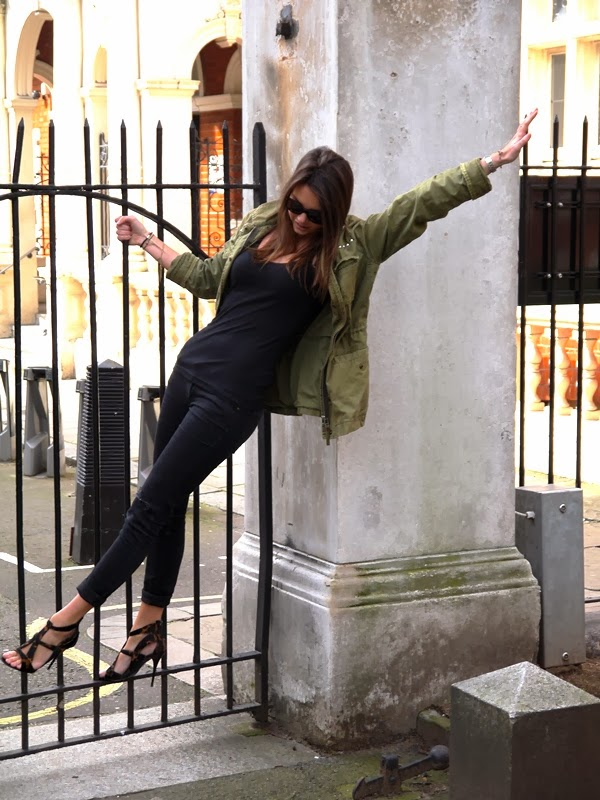 Khaki parka and Giuseppe Zanotti heels in Mount Street Gardens, Mayfair