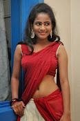 Chaithra setti sizzling in half saree-thumbnail-15