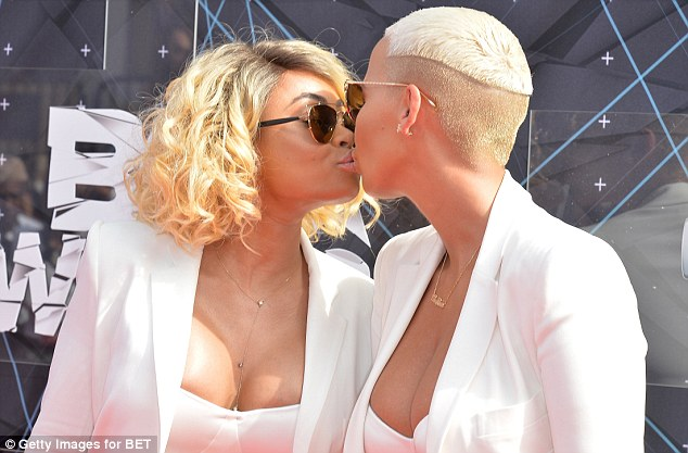 Amber Rose and Blac Chyna share a kiss in matching ensembles at the 2015 BET Awards in LA