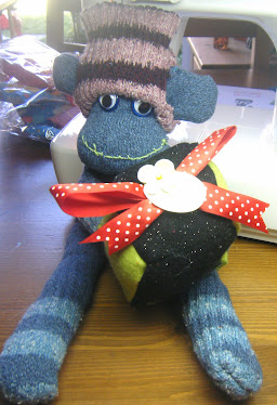 HANDCRAFTED SOCK MONKEY WITH PRESENT