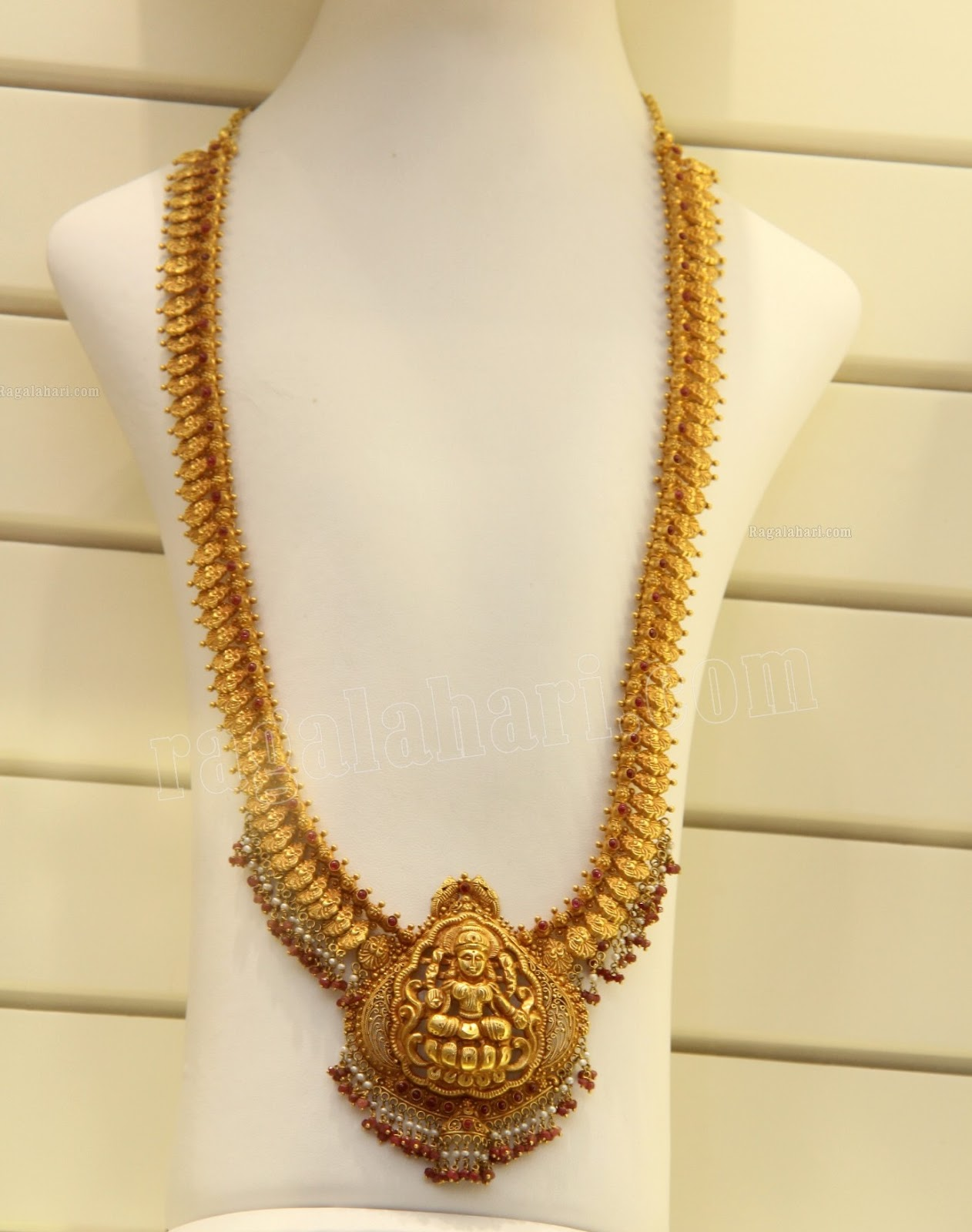 Suhasini in gundla haram jewellery designs - Antique Long Chain