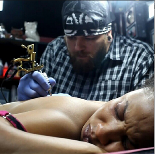 Picture of Tonto Dikeh in Pains as She Gets Her Own Tattoo