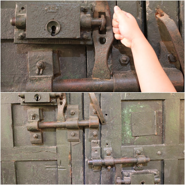 The giant door hinge of the main front gate of Maison Centre (Hoa Lu Prison) in Hanoi, Vietnam