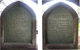 A pair of bronze plaques set in simple wooden frames.  Each plaque is headed with the word 'Fallen' and then has a short list of names