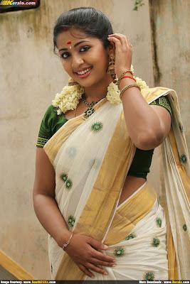 Navya Nair saree navel show hot pics