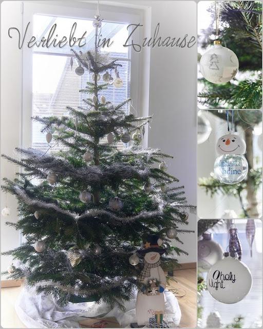 Winterlicher Weihnachtsbaum in Silber und Weiß geschmückt