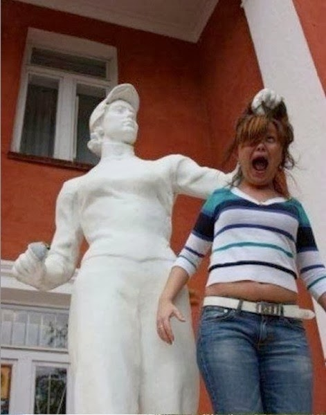Tourist Posing Inappropriately with Statues  3