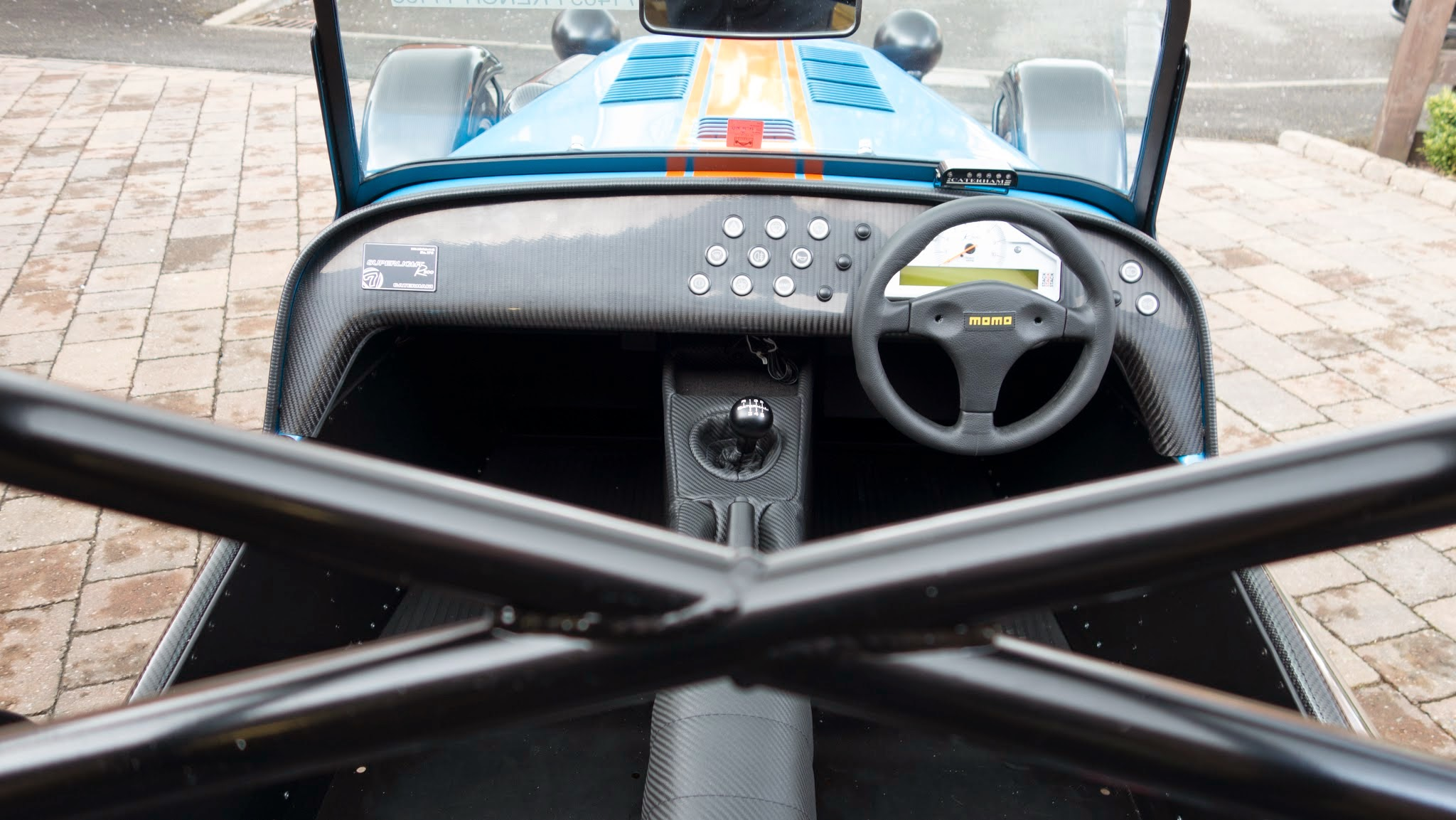 Overhead shot of interior with track day roll bar in foreground.