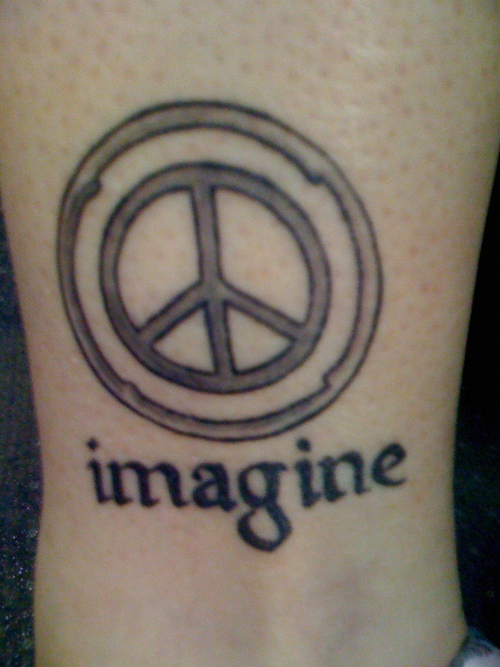 Free Amazing Styles Peace Sign Tattoos Designs And Ideas