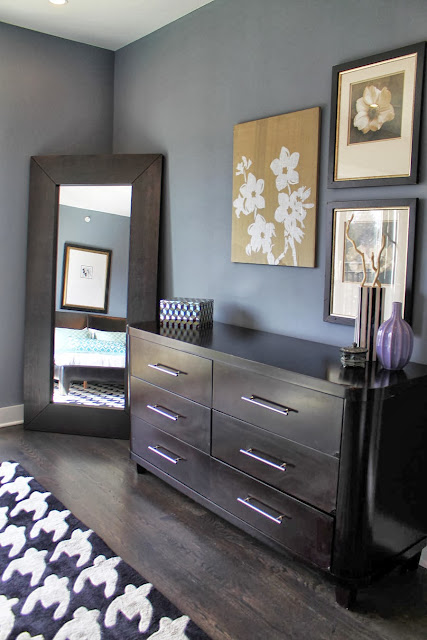 cool and classy drawer and mirror design in line with traditional flower wall pictures and contemporary details