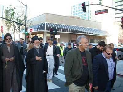 Sajjad Mir, second from right (hand in pocket), marching during a Husayn Day 'Peace' Walk. Mir is the Chairman of Shia Association of Bay Area, Vice Chair of the Northern California Islamic Council (NCIC) and President/CEO of Hastest Solutions, Inc. Photo by Sam Bazzi, The Islamic Counterterrorism Institute.