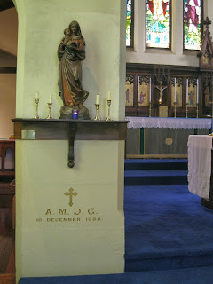 AMDG on the foundation stone of the church