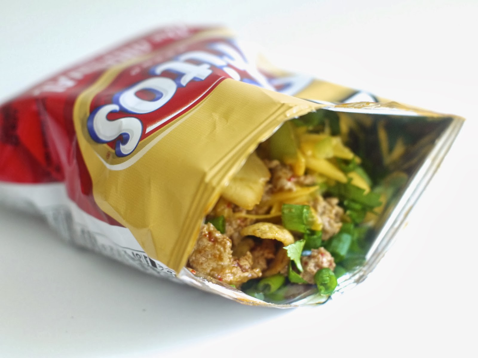 is no joke. Frito Pie is simply chili scooped into a bag of Fritos ...
