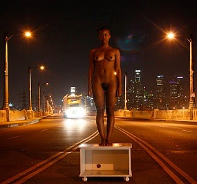 William Springfield: Girl on a coffee table on the highway.