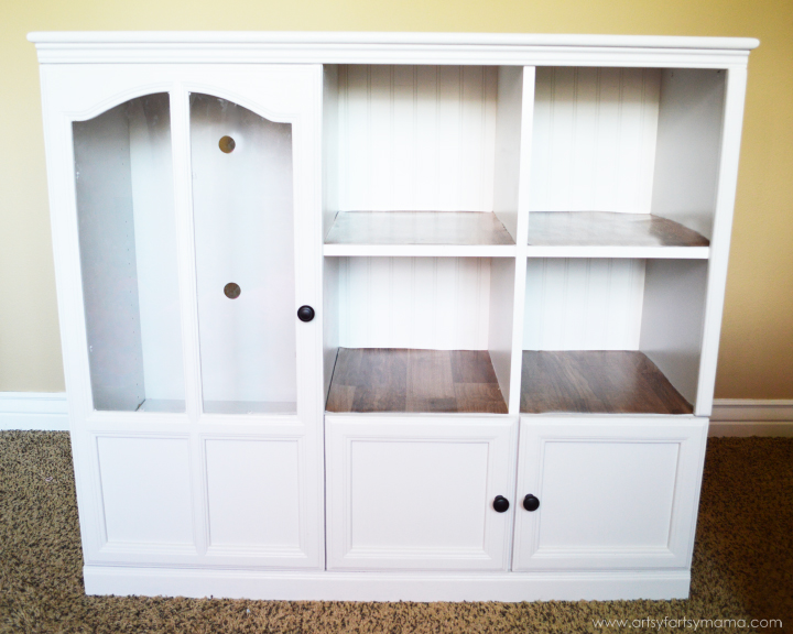 Entertainment Center to DIY Dollhouse and Dress-Up Cabinet from artsyfartsymama.com #upcycle #dollhouse #Barbiehouse