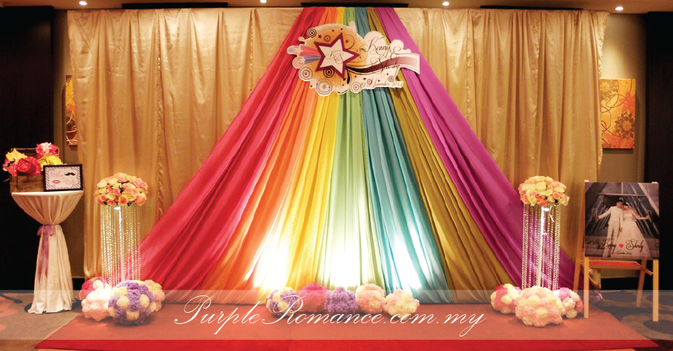 Photo Booth Backdrop Decoration, Kuala Lumpur, 婚礼装饰服务, Sheraton Imperial Hotel Kuala Lumpur, Malaysia, Selangor, KL, rainbow colour, light purple, pom pom flowers, red carpet, welcome board, props, logo design, pink, orange, yellow, green, blue, purple