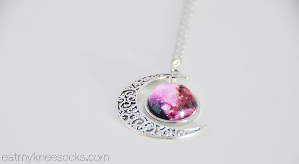 The starry sky/galaxy-print moon pendant necklace from Born Pretty Store.