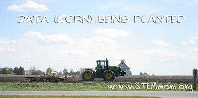 Tractor planting corn in a midwest field