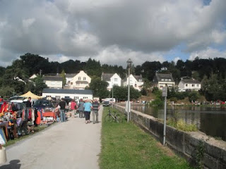 La Cheze summer festival, car boot sale and stalls around the edge of the lake