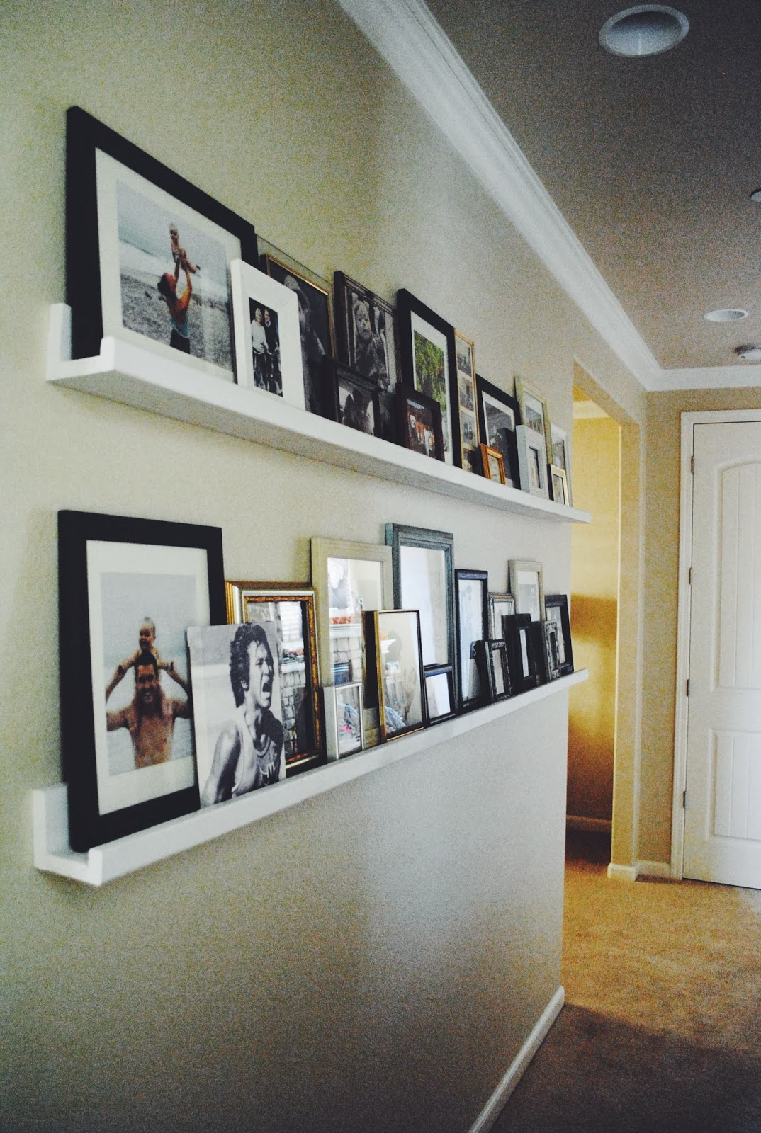 Notes from nessa diy picture ledges for Displaying pictures in your home