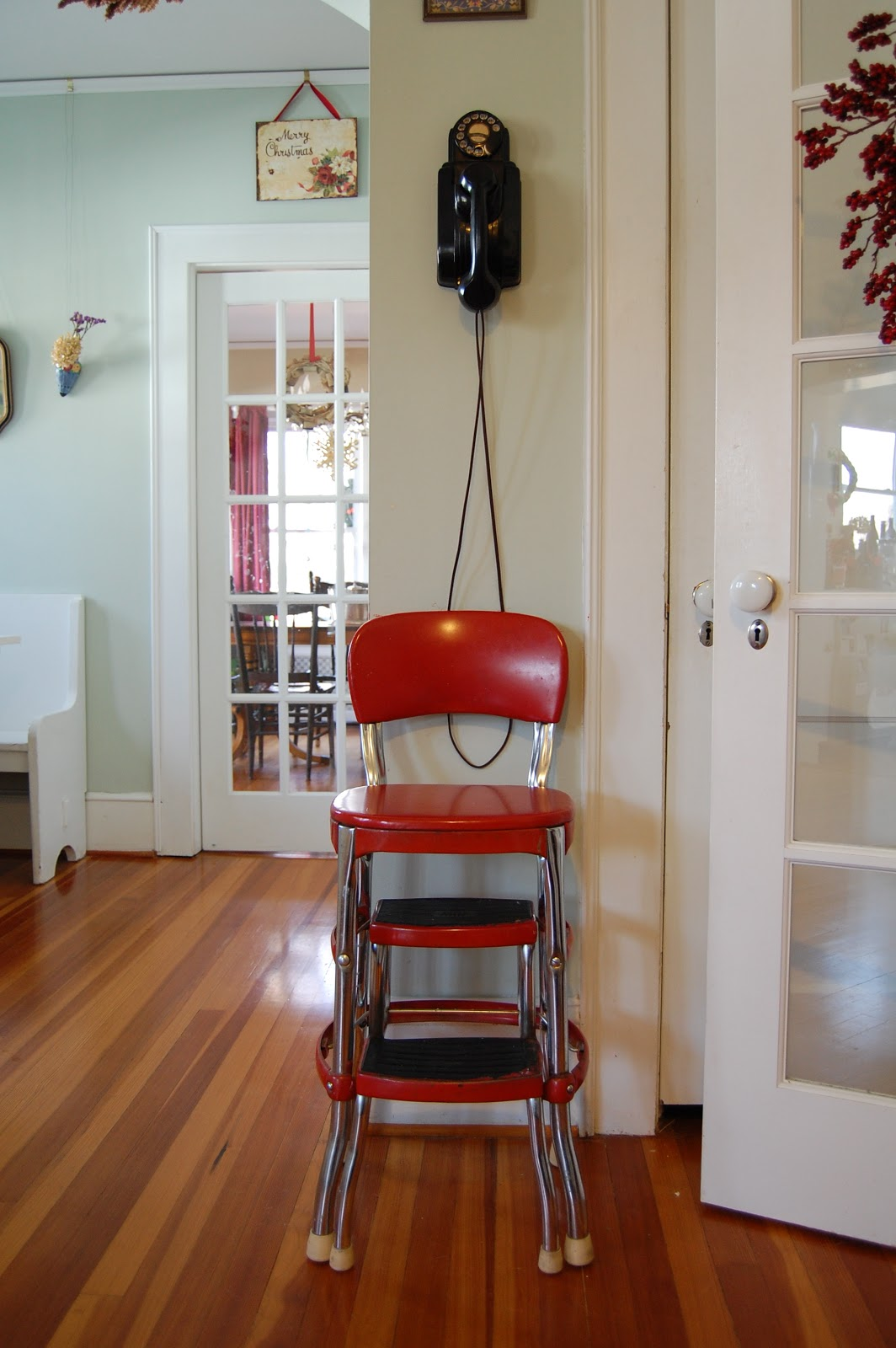 A Vintage Wall Phone And Cherry Red Step Stool Add To The Charm Of Their  Vintage Style Kitchen.