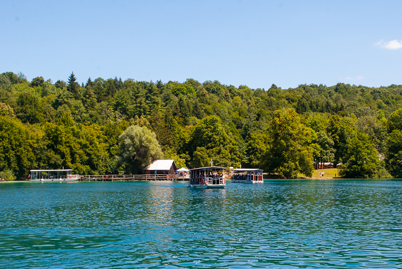 lovely pretty green trees and the lake with boats at Plitvice Lakes National Park