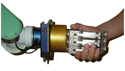 A photo of showing the arm of a robotic giving a handshake to the arm of a human