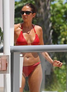 Olga Kurylenko turns the heat on in a sexy red bikini