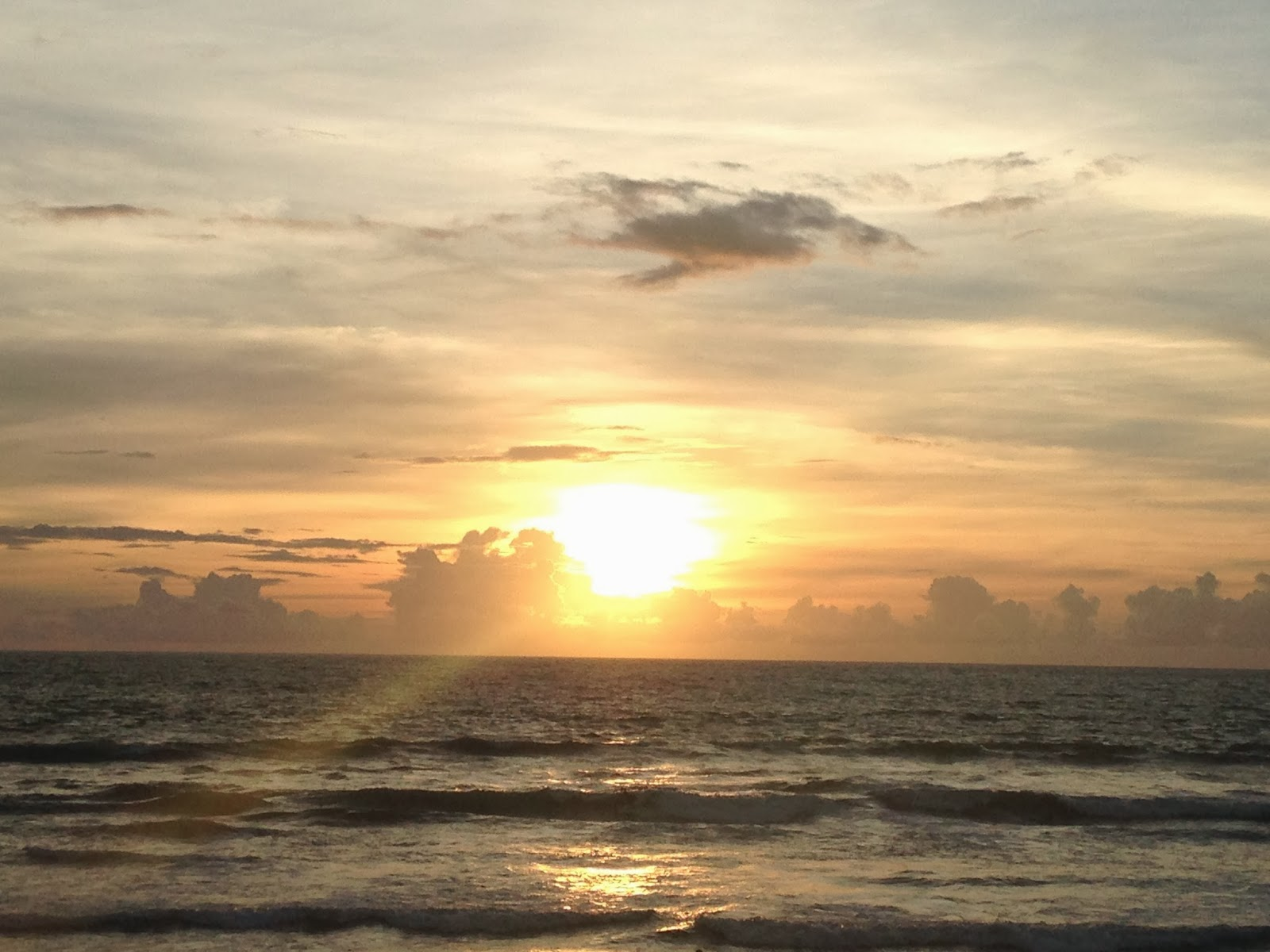 sunset seminyak bali indonesia
