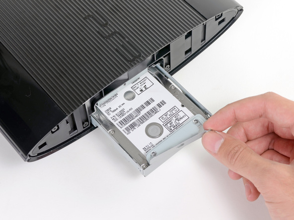 insert the new hard drive into PS4 drive bay