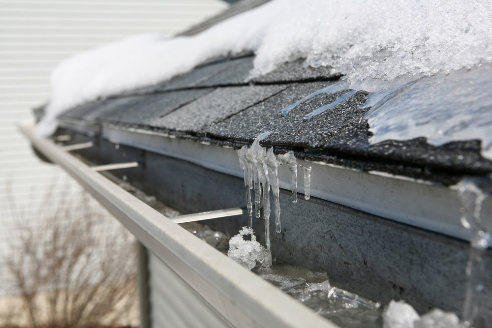 Above beyond roofing lake of the ozarks keep snow and for Roof leaking in winter