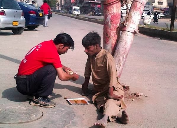 When this shop owner went outside to feed a disabled homeless man.