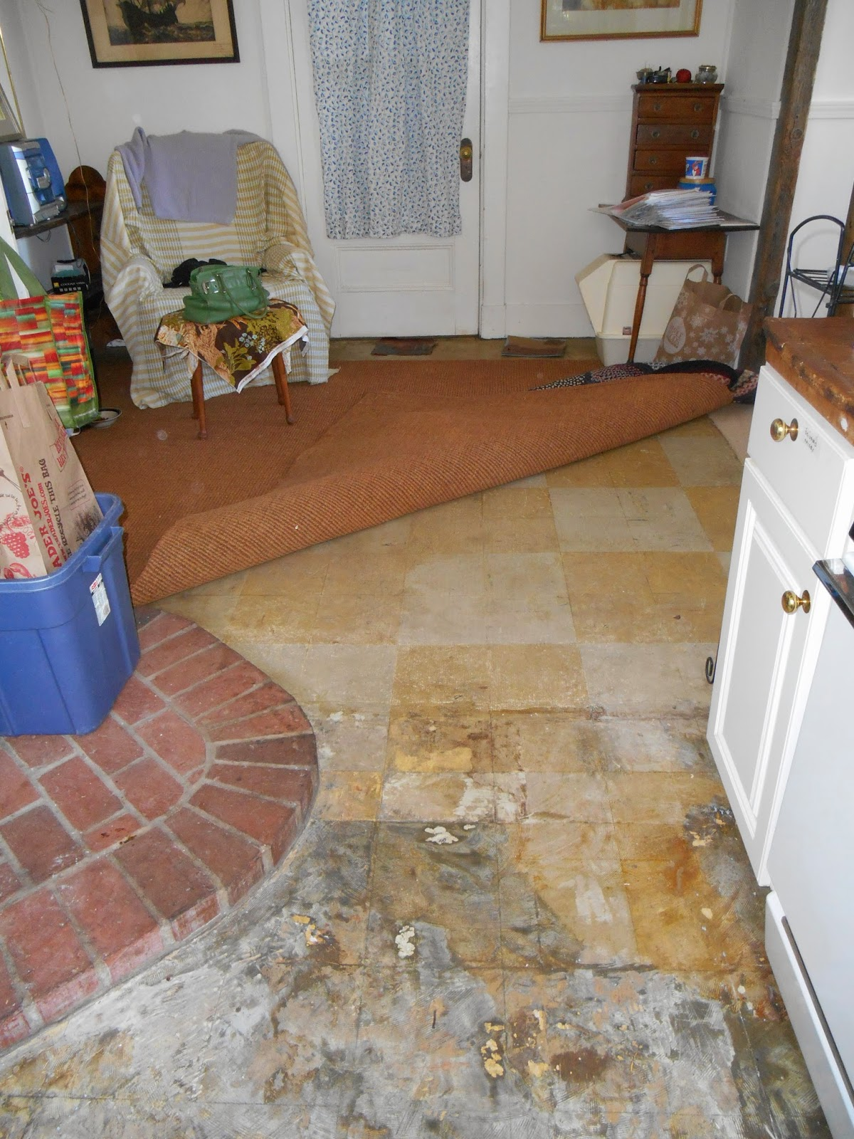 Living designs a paper bag floor over asbestos linoleum old linoleum under coir rug and also under newly removed blue linoleum showing black mastic dailygadgetfo Images