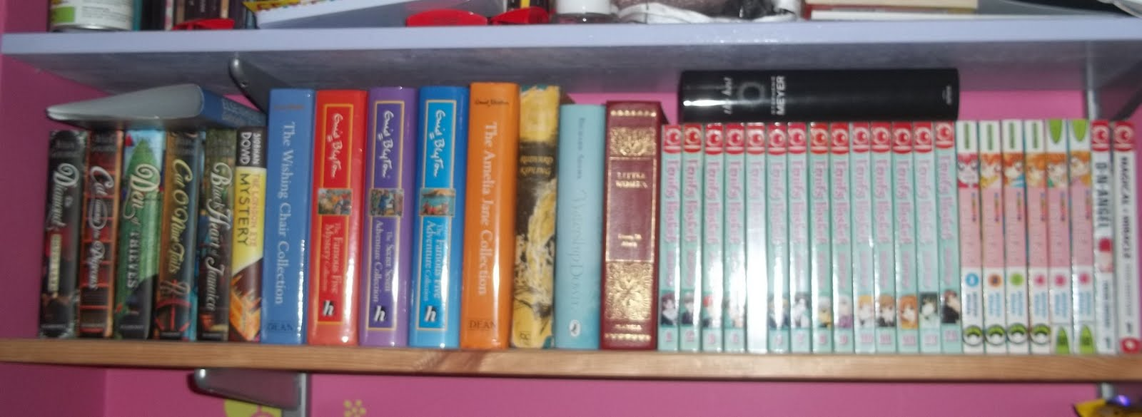 On This Little Shelf Above All My Other Shelves Is Where I Keep Small Manga Collection Mostly Fruits Basket And Momote Lollipop Enid Blyton