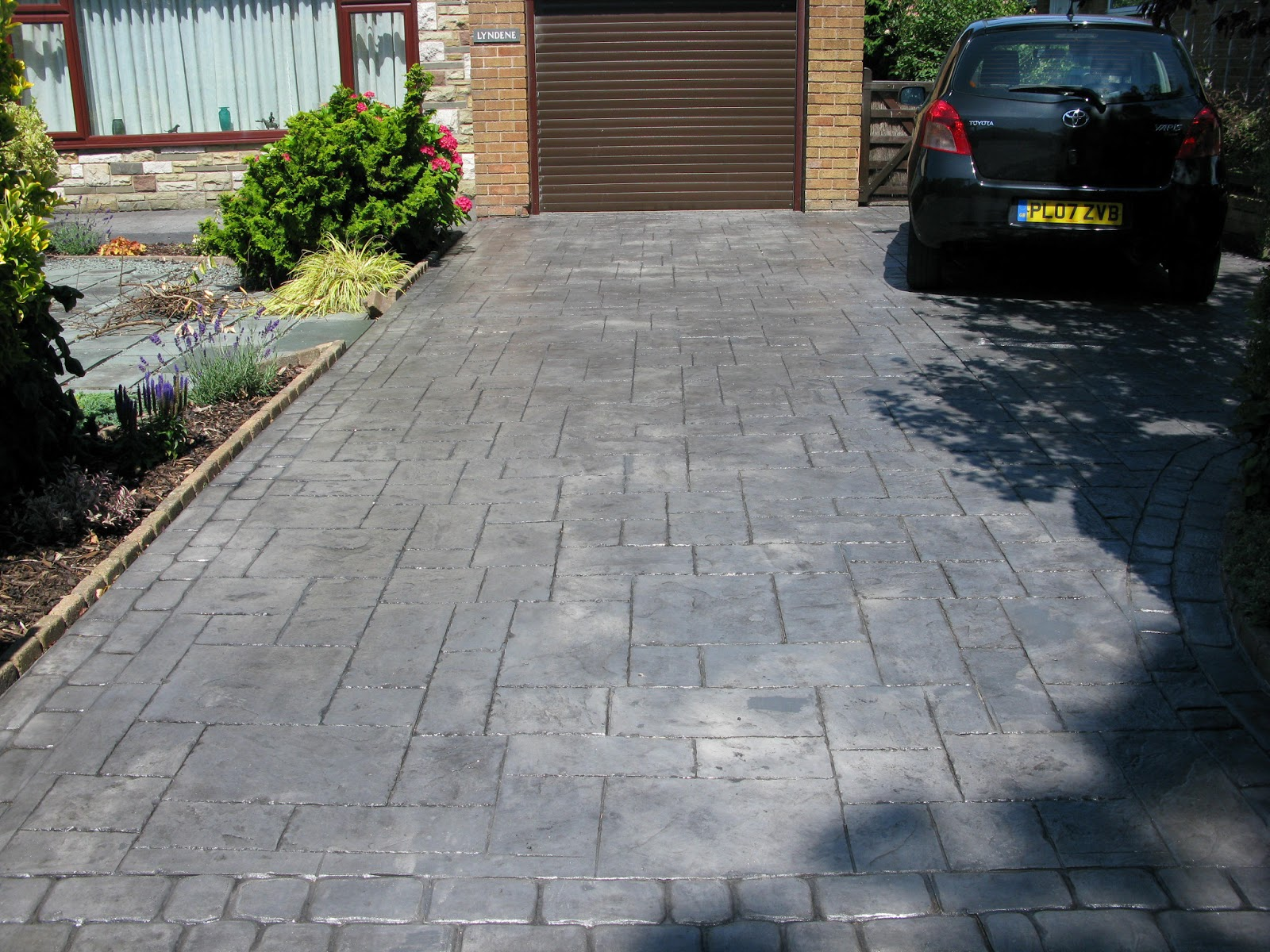 Northern cobblestone blog pattern imprinted concrete for Adoquines para jardin