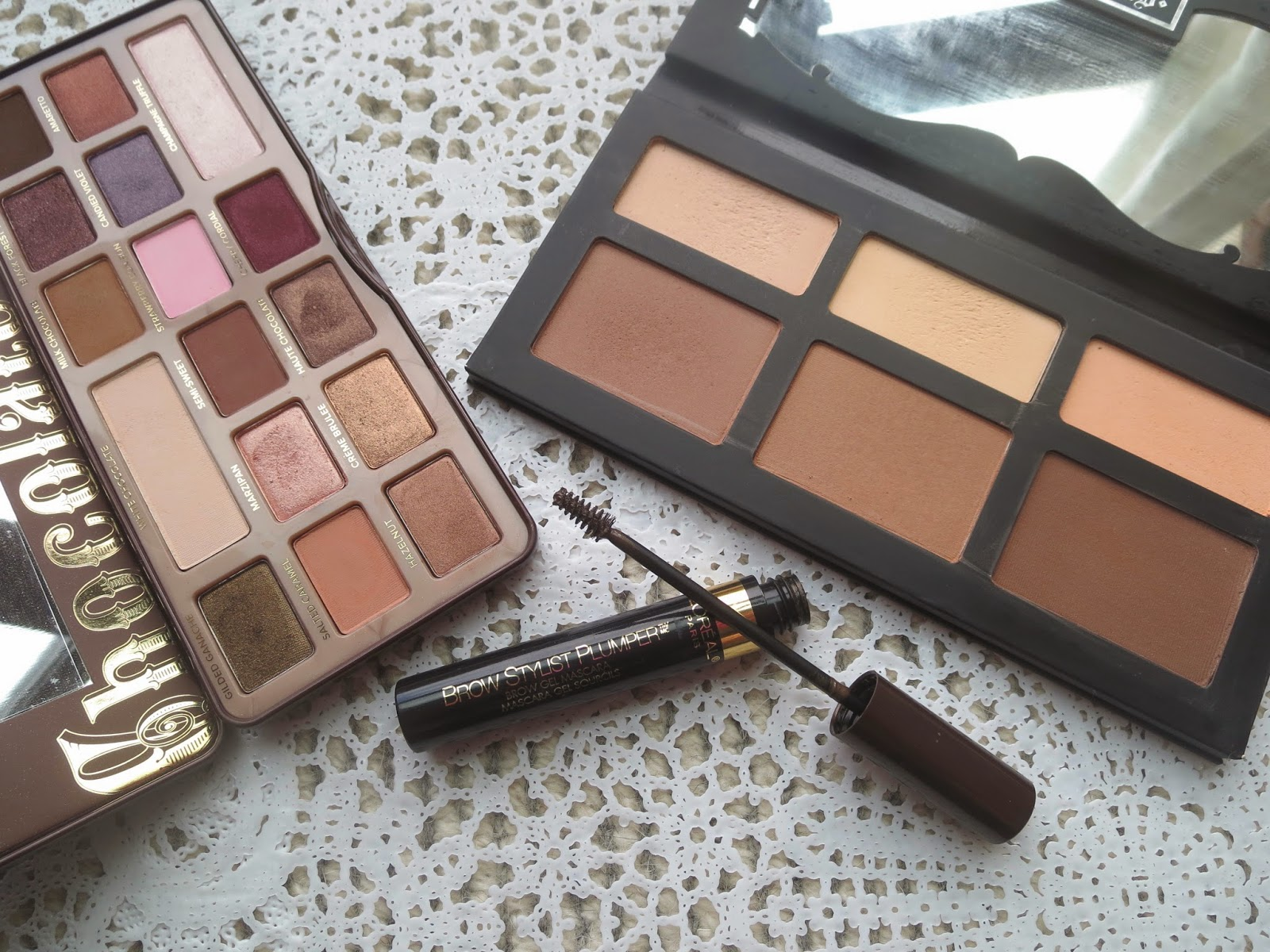 a picture of Too Faced Chocolate Bar, Kat Von D Shade + Light, L'Oreal Brow Stylist Plumper