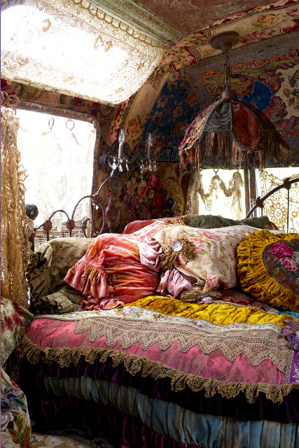 This is Bohemian gypsy to the extreme. The ornate linens, lace, fringe ...