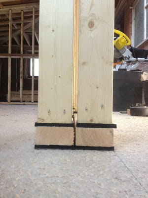 studs and base-timbers separated by foam