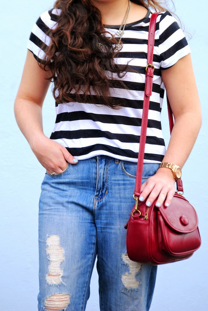 striped tee, distressed denim, pop of color