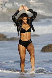 Ciara dancing on the beach in a bikini and leather jacket