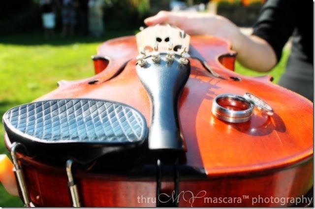 Wedding rings on a violin