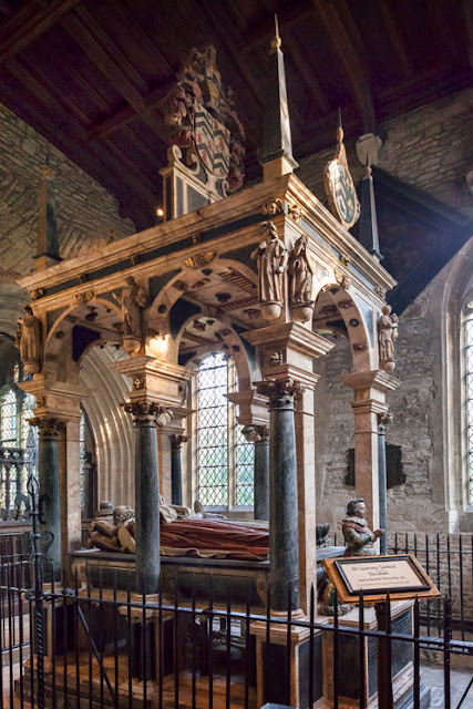 An ornate tomb in the Burford church of St John's in the Cotswolds by Martyn Ferry Photography