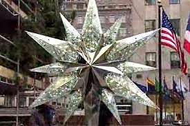 A 550 Pound Swarovski Crytal Star Tops the Rockefeller Center ...